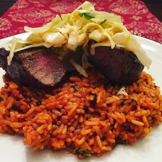 Back_at_it__Chili_rubbed_steaks_over_tomato_rice_topped_with_a_quick_kimchi.__bachef__blueapron